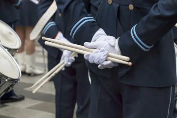 Men with drumsticks