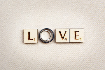 Wedding Rings on Scrabble LOVE letters