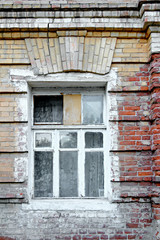 Old window in aged slum house in Russia