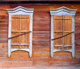 Two weathered window of old hut in Russia