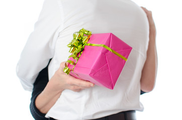 Couple hugging, woman holding a gift