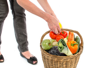 Woman with a basket full of vegetables