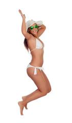 Funny girl in bikini jumping