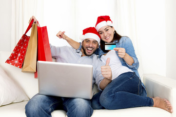 young couple online Christmas shopping with computer