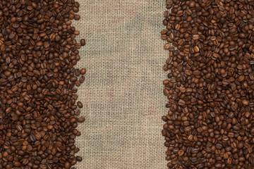 Coffee beans on a jute background