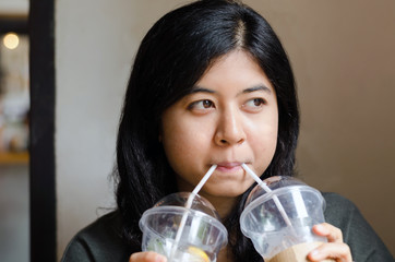 Woman drinking a two cups of coffee