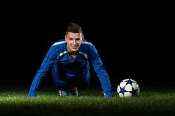 Soccer Player Doing Push Ups