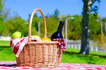Picnic basket with fruits and wine