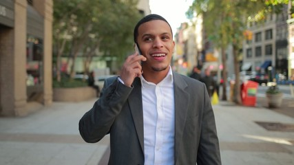 Young African American black Latino man talking on cellphone