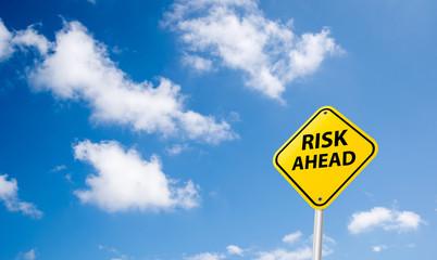 risk ahead sign on sky
