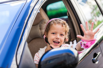 Young girl driving daddy's car