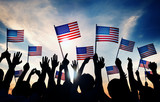 Group of People Waving American Flags in Back Lit - 72235664