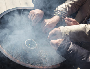 Incense burn with hands
