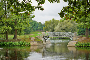 Metal bridge over flow in the palace park in Gatchina