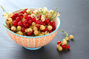 fresh berries in a bowl on background