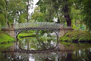 Picturesque landscape with old bridge over flow