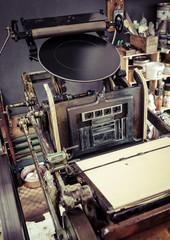 Printing press machine in workshop,Vintage object
