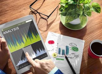 Man Analysis Stock Exchange on Tablet