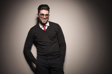 business man smiling while holding his hands in pocket