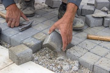 laying concrete brick pavers