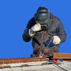 Welder working on a construction site.