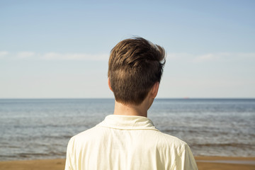Guy looks at the sea