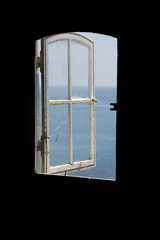 Indonesian lighthouse window and sea view
