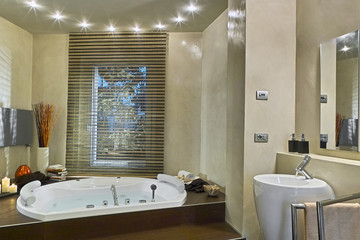 inside view of the modern bathroom overlooking  on the bathtub