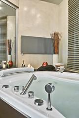 detail of the bathtub, the taps  in a modern bathroom