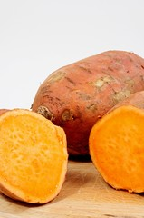 Raw sweet potatoes © Arena Photo UK