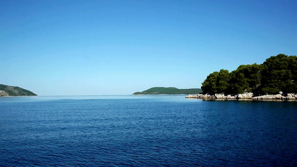 Sailing at blue Adriatic sea with beautiuful view at islands
