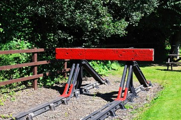Red railway buffer stop © Arena Photo UK