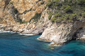 Boat with oarsmen at rocks. Europe. Spain