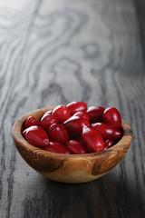 ripe cornel berrys in bowl