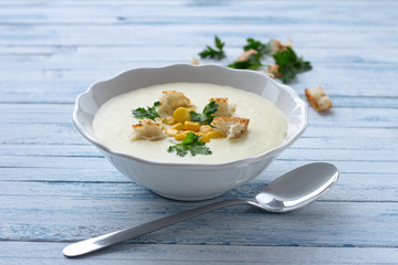 Vegetables cream soup with corn, croutons and parsley