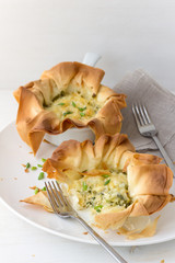 Onion mini tarts of filo pastry with cheese