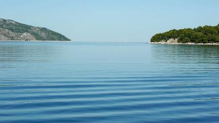 Morning at blue sea near island