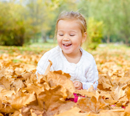 little girl have fun in autumn