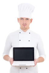 young man in chef uniform holding laptop with blank screen isola