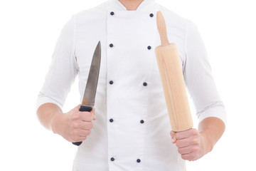wooden baking rolling pin and knife in chef hands isolated on wh