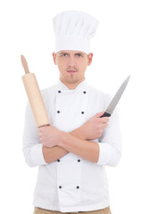 young man in chef uniform with wooden baking rolling pin and kni