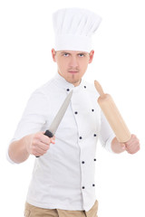 funny young man in chef uniform with wooden baking rolling pin a