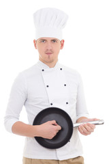 funny young man in chef uniform playing frying pan like a guitar