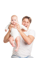 Happy young man holding smiling baby isolated