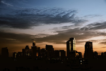 Background of cityscape silhouette with dramatic dark sky
