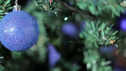 Hollyday videocard. Blue ball on christmas tree