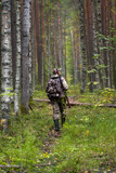 hunter with gun in the forest