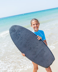 Teenage girl surfing