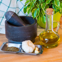 bottle of olive oil, mortar and pestle