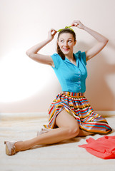 Funny pinup woman posing on furry carpet